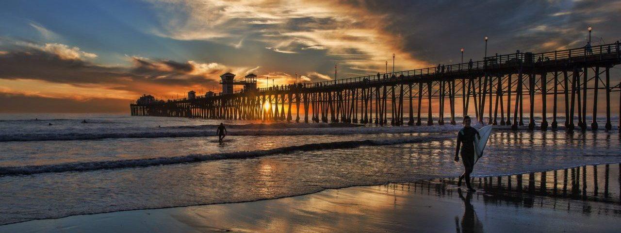 Pier Sunset Surfers